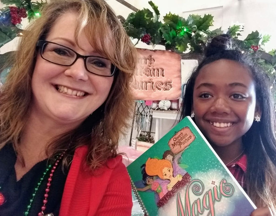 author kelly parke with happy customer and former student